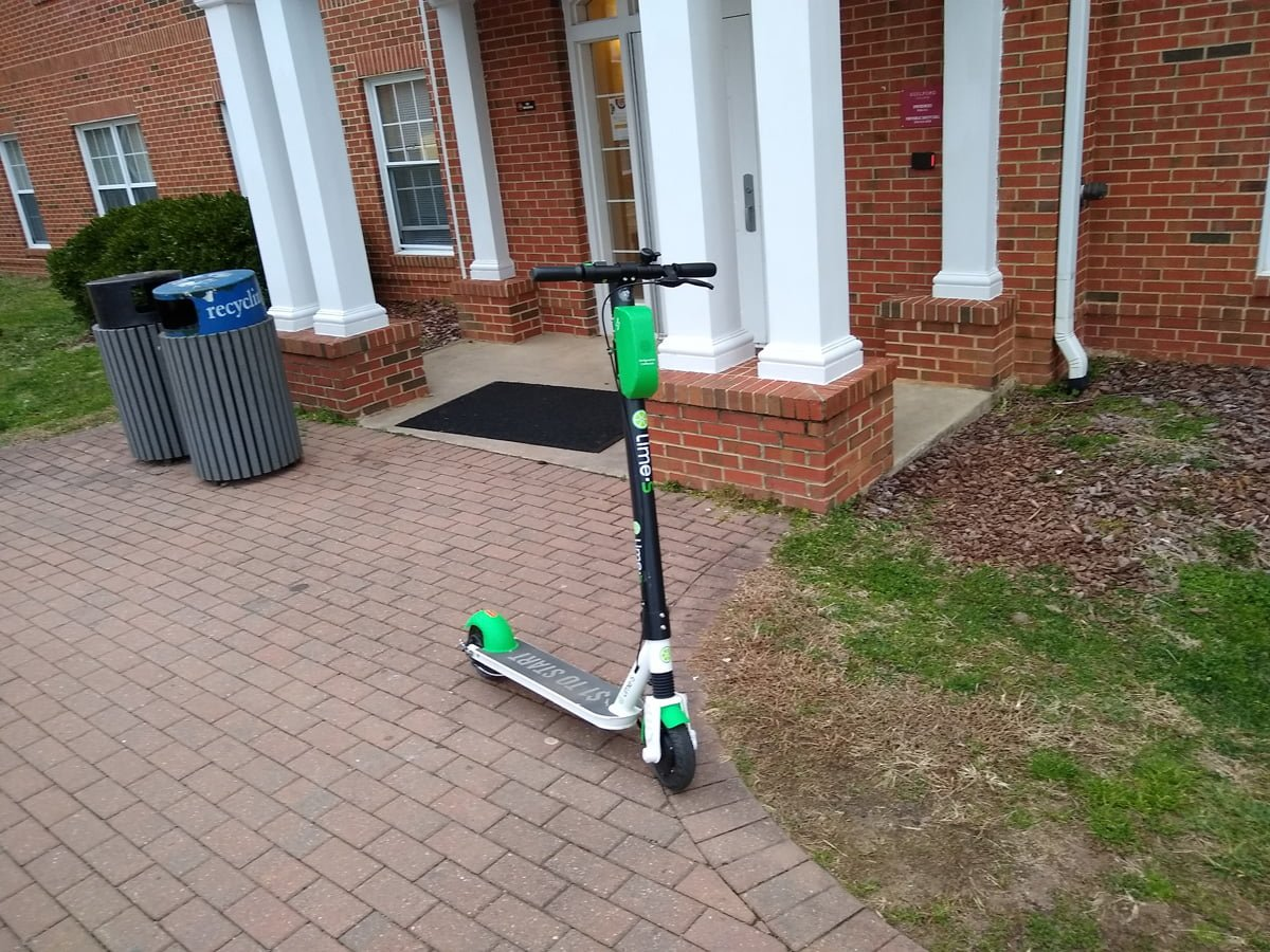 A Lime-S electric scooter sits outside of the South Apartments. The scooters are part of a pilot program by the City of Greensboro.//Photo By Andrew Walker/The Guilfordian