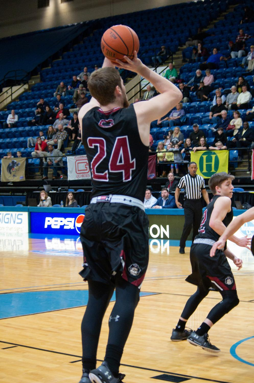 Guilford College junior forward Kyler Gregory scores in the ODAC Tournament Championship game on Feb.24. On Mar. 8, Gregory led Guilford with 31 points in a loss to University of Wisconsin-Oshkosh in the NCAA Division III Championship Quarterfinals.(File photo)//Photo by Andrew walker/The Guilfordian