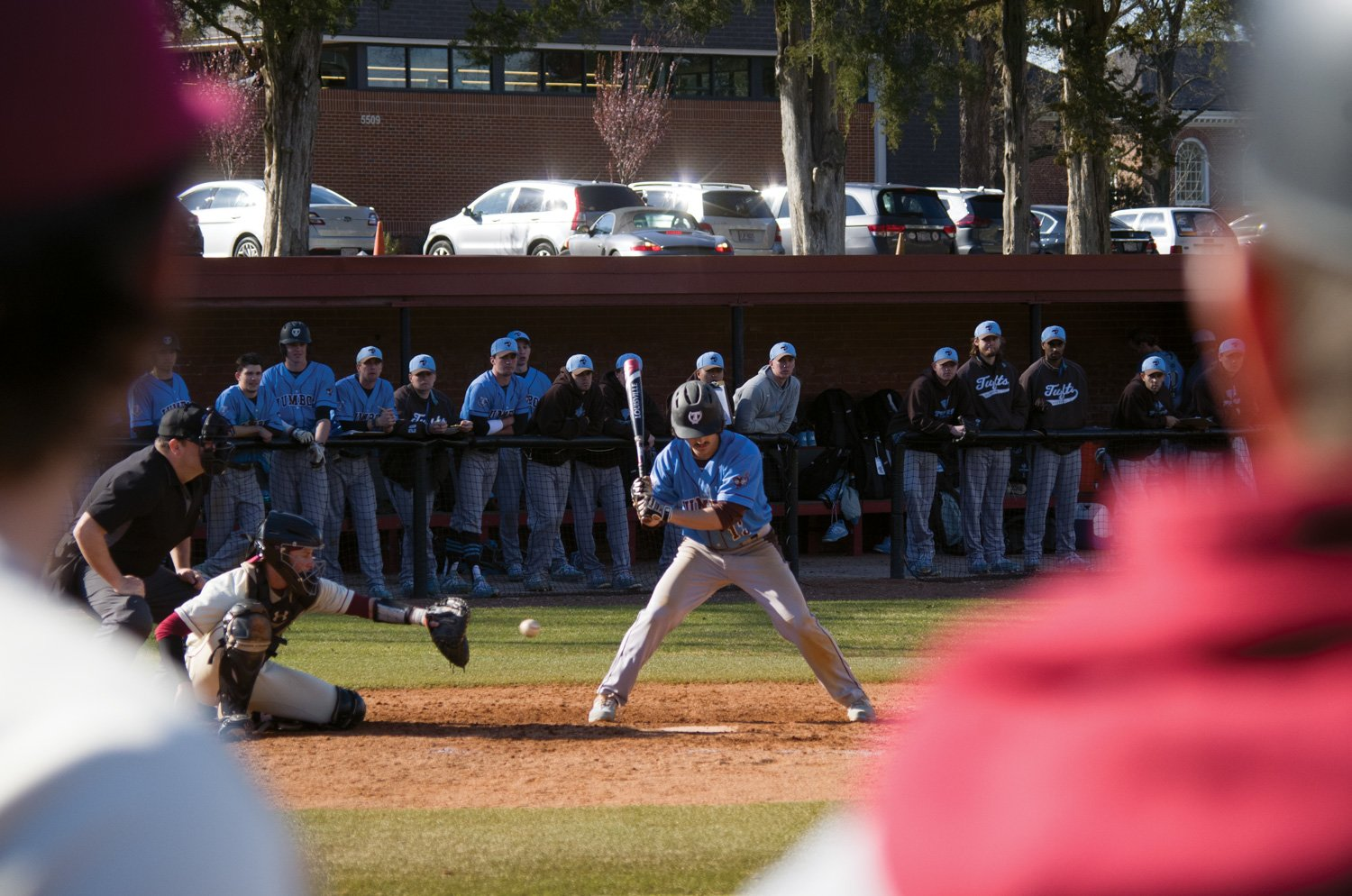 Tufts University third baseman Elias Varinos watches Guilford junior catcher Ryan Hill catch a pitch from junior pitcher Brody Holloman on Mar. 18.//Photo by Andrew Walker/The Guilfordian