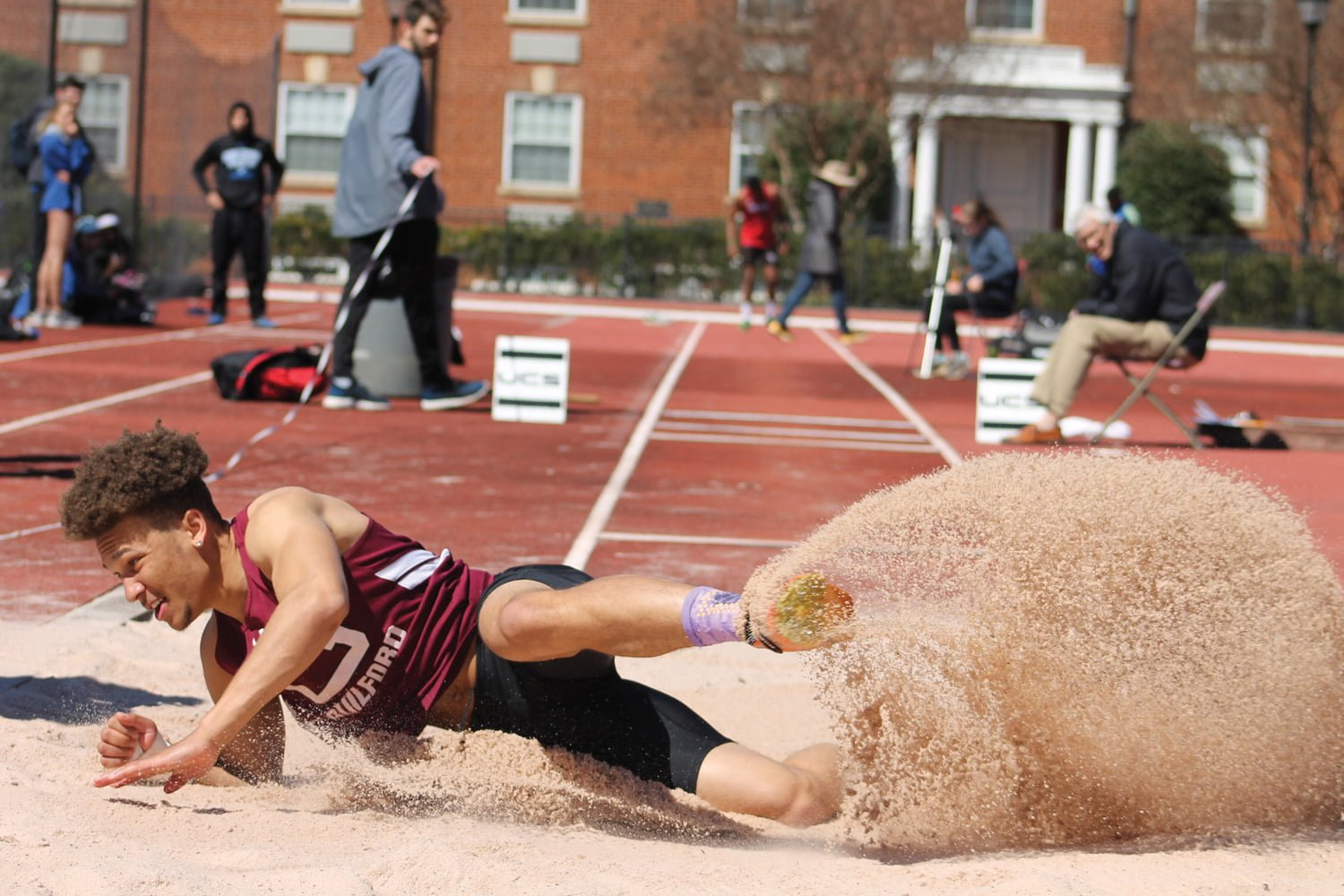Junior jumper Jeremiah Hedrick lands after attempting the triple jump at the Dr. Jack Toms Invitational at the University of Lynchburg. //Deanna Lassiter/Guilford Athletics