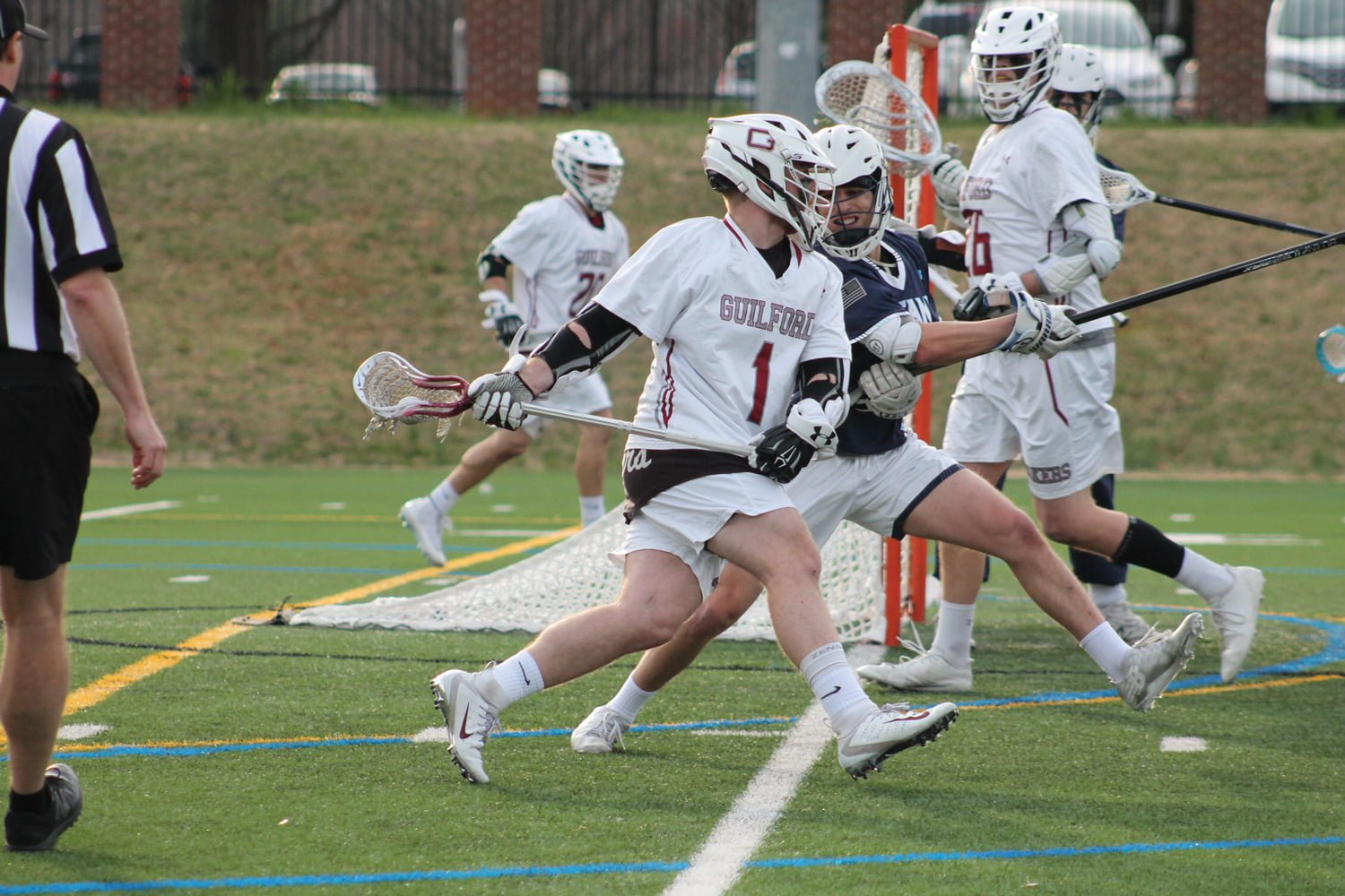 Junior attacker Connor Sweeney tries to get by a Westminster College defender on March 13. //Photo By: Deanna Lassiter/Guilford Athletics