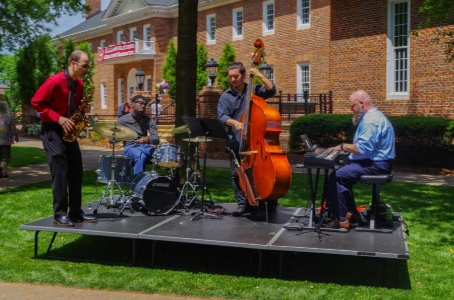 The Guilford College Jazz Quartet of Drew Hays (left), Asa Bell '21 (center left), Brandon Walker '21 (center right) and Matt Reid '16 (right) performed during the reception after the commencement.