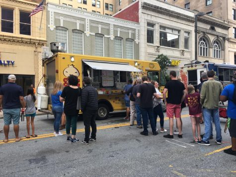 Community members patiently line up to order food at the wide array of different food trucks at the festival.