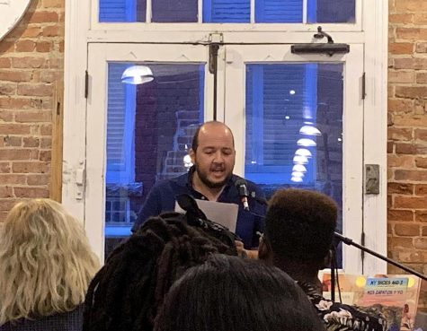 Writer Oswaldo Estrada, a UNC-Chapel Hill professor of Spanish and Latin American Studies, reads at Scuppernong Books during the Writers for Migrant Justice event on Sept. 4.