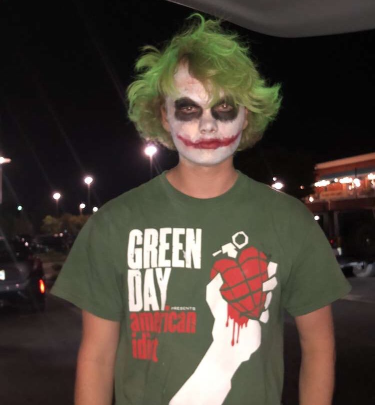 Caleb+Youngdahl%2C+pictured+above+in+his+Joker+costume%2C+was+followed+by+a+security+officer+at+a+theater+in+High+Point+and+eventually+had+to+remove+the+makeup+because+of+safety+concerns.+