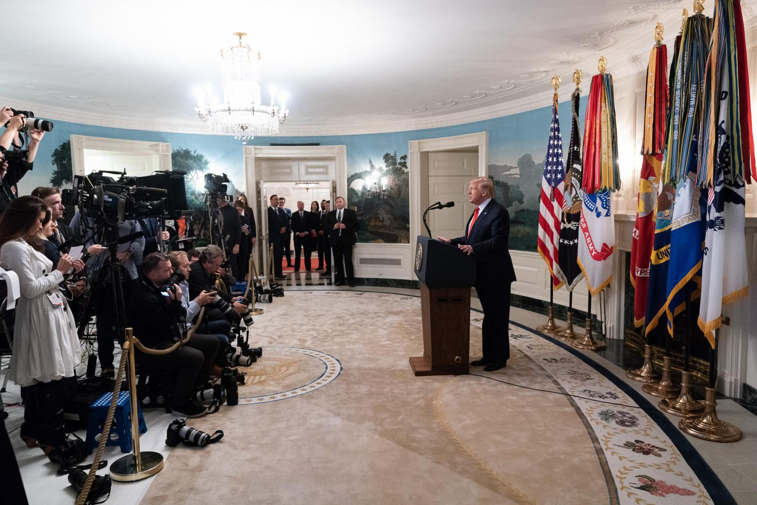 Trump announces details of the mission to the press in the Diplomatic Reception Room of the White House.