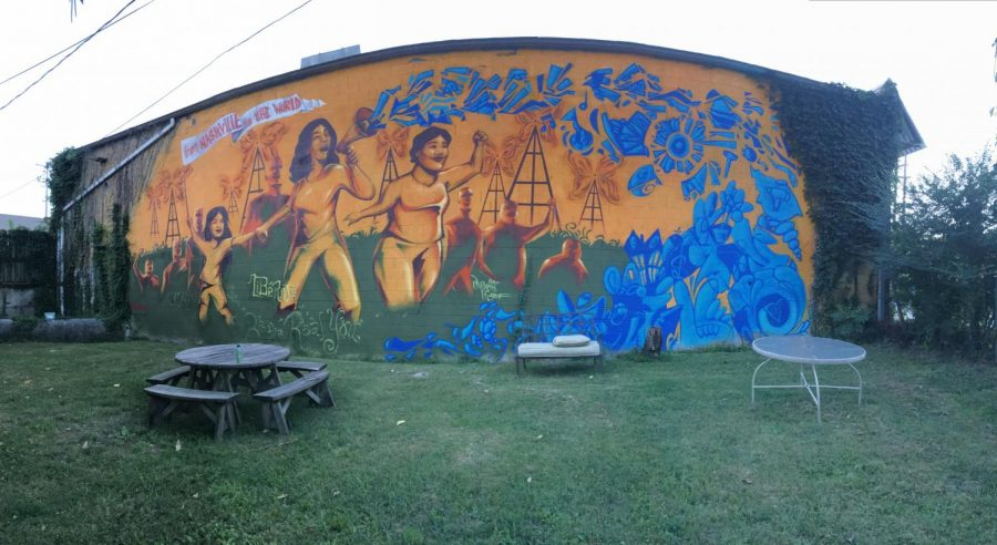 During the three-week semester, senior Theo Baker participated in the Social Justice in the Southern U.S. study away course. The course traveled to various cities in the south to explore pressing social justice issues and learned how local community-based groups address these issues. This mural is outside Workers' Dignity, a worker-led organizing center for economic justice.