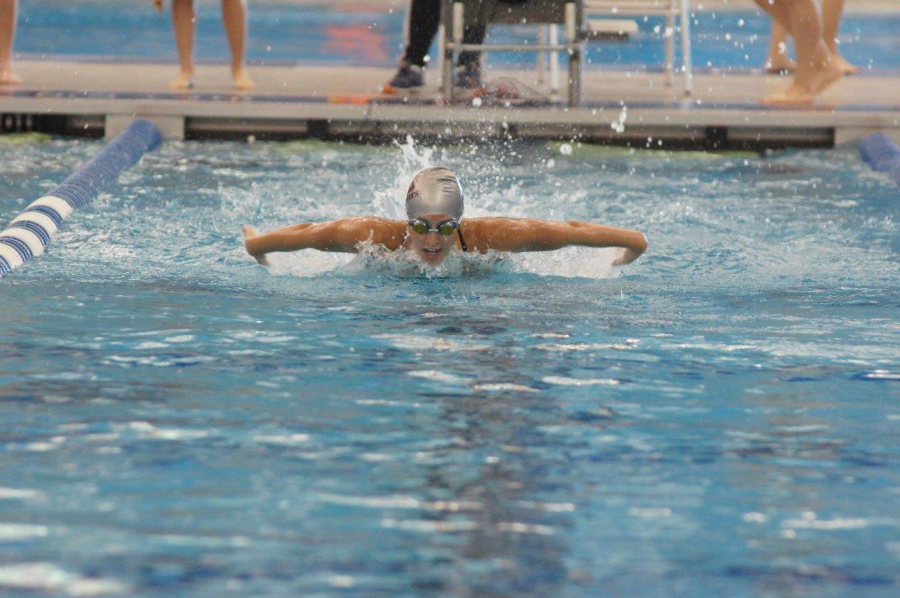 Carolyn O'Halloran competes in a butterfly event