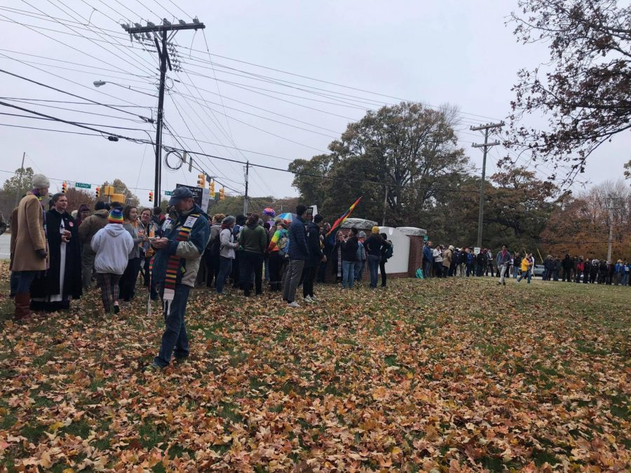 Guilford College community, alumni, locals, and clergy gathered to turn their backs to Westboro Baptist Church during the Barrier of Love Event on Monday.