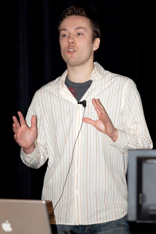 An image of David Hansson, a programmer, speaking at a tech conference in California.