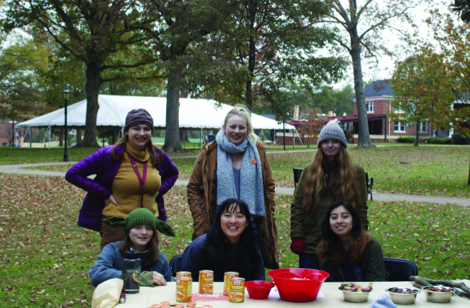 ROAR+volunteers+bring+treats+to+dogs+and+cats+during+Guilford+College%E2%80%99s+Fall+Fest.