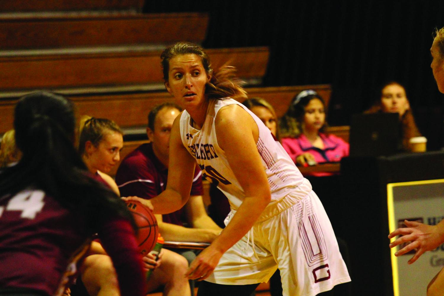 Junior Julie Carini searches for an open teammate in a Nov. 4 scrimmage.