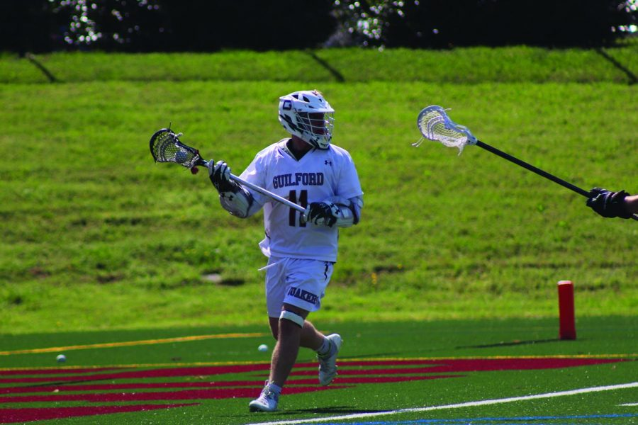 Senior attackman Brennan Sweeney dodges towards the goal.