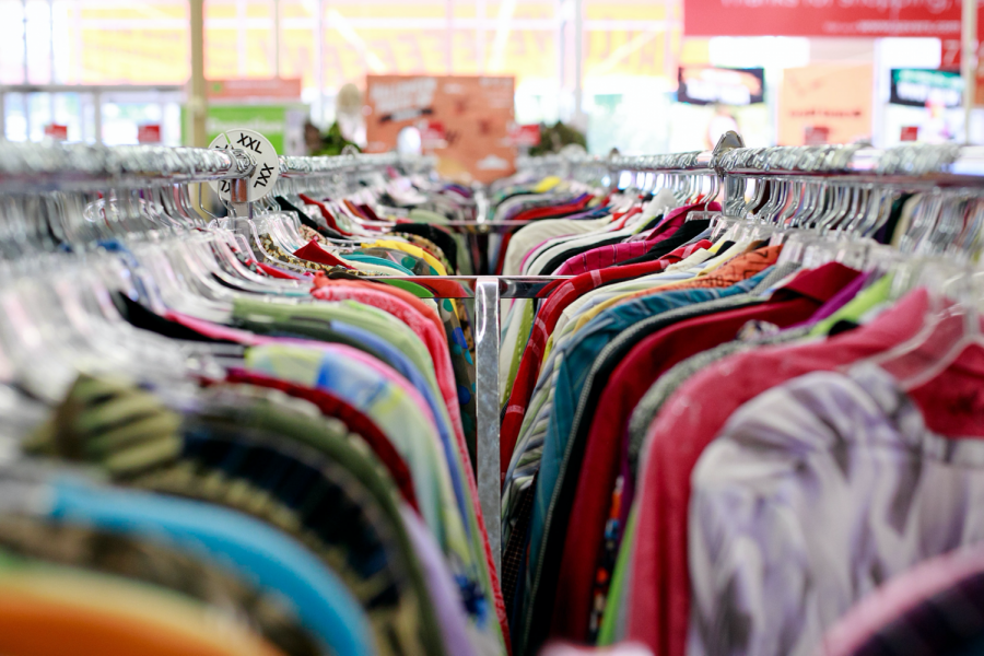 A clothing rack at a thrift store.