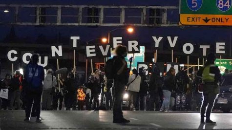 """Marchers hold letters up that spell out """"Count Every Vote"""" as they make their way across an overpass in Portland, Ore., Wednesday, Nov. 4, 2020, following Tuesday"""