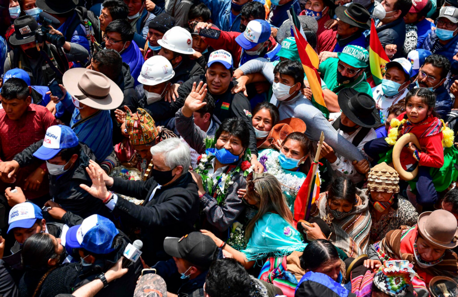 Evo Morales, center, is greeted by supporters as he returns to Bolivia.