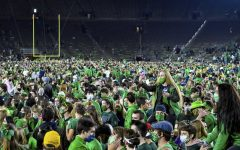 Thousands of fans rush the field after Notre Dame's victory against Clemson.