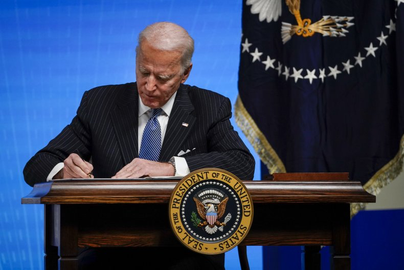 Newly elected President Joe Biden signs an executive order on Jan. 25, 2021.