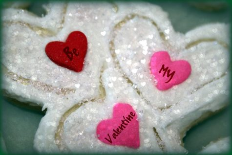 "Heart-shaped candies with the words written on them ""Be My Valentine""."