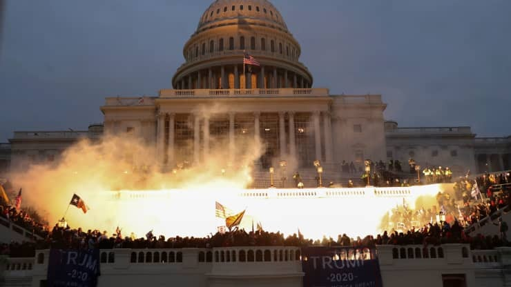 An+explosion+caused+by+a+police+munition+is+seen+while+supporters+of+U.S.+President+Donald+Trump+gather+in+front+of+the+U.S.+Capitol+Building+in+Washington%2C+U.S.%2C+January+6%2C+2021