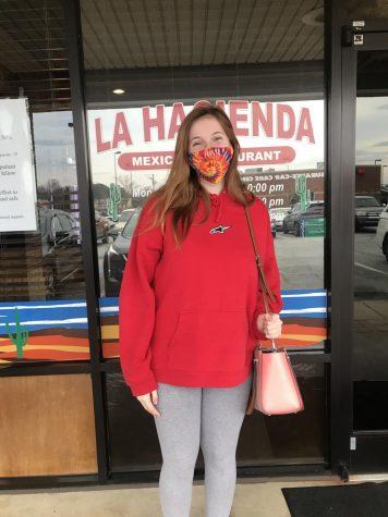 Victoria Anglin picking up food at La Hacienda restaurant.