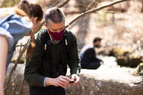 Jim Hood works with a student in his American Nature Writing course this spring during a class exploration in the Guilford Woods.